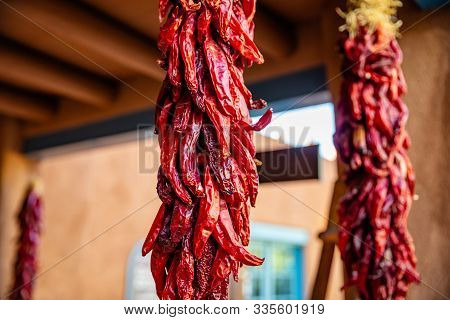 Red Hot Chili Peppers Ristras Dried Bunch Hanging On A Traditional Building Entrance, Santa Fe New M