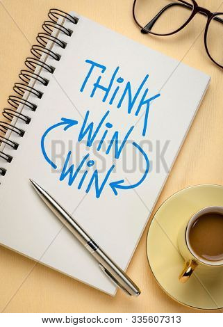 think win-win strategy concept - a sketch in a notebook with a cup of coffee, business negotiation, cooperation and solution