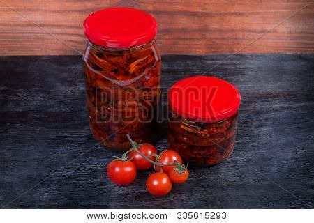 Sundried Red Tomatoes Preserved In Olive Oil In Two Different Small Closed Glass Jars, Branch Of Fre