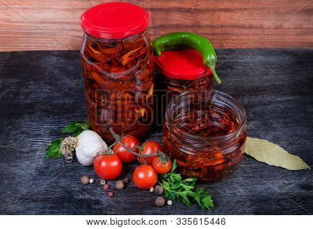 Sundried Red Tomatoes Preserved In Olive Oil In Two Different Small Closed Glass Jars Among Ingredie