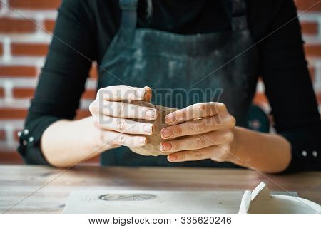 Woman Making Pottery, Hands Closeup, Blurred Background, Focus On Potters, Palms With Pottery. Conce
