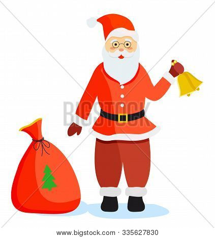 Santa Claus Standing On Ground Alone. Person In Red Warm Clothes With Bells In Hand. Colorful Sack O