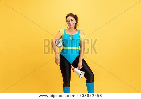 Young Caucasian Plus Size Female Models Training On Yellow Background. Stylish Woman In Bright Cloth