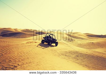 Quad Buggi Bike Vehicle Car Ride At Desert Dunes At Al Awir Desert Near Dubai, Uae At Sunset Light