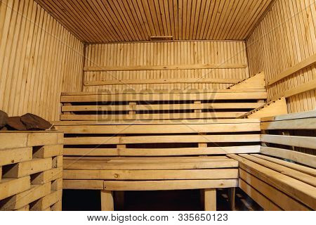 Wooden Bathhouse Sauna Benches Interior. Recreational Room. Relaxing Leisure In Bath-house.