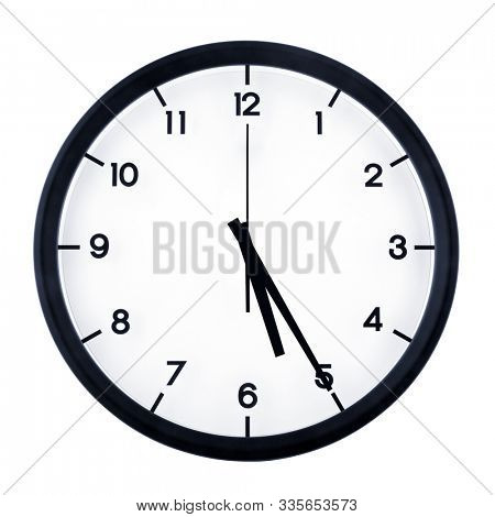 Classic analog clock pointing at five twenty five, isolated on white background.