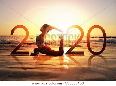 Happy New Year Card 2020. Silhouette Of Healthy Girl Doing Yoga One Legged Pigeon Pose On Tropical B