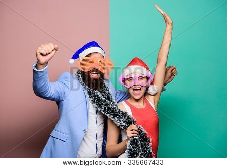 Winter Corporate Party. Office Christmas Party. Happy Man And Woman Wear Santa Hats And Funny Sungla