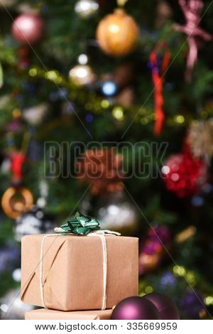 Gift Wrapped Christmas Presents Under The Decorated Christmas Tree In Cosy Family Home Interior