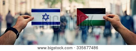 Hands Holding Palestine Vs Israel Flags As Dispute On Politics, Culture, Religion And Territory. Dip