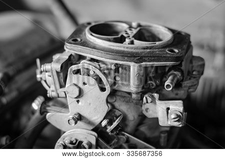 Close-up Of A Car Gasoline Carburetor. Carburetor Without Top Cover. Without People. Selective Focus
