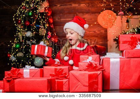 Santa Brought Me Gifts. Child Happy Excited Girl Find Gifts Near Christmas Tree. Happiness And Joy.