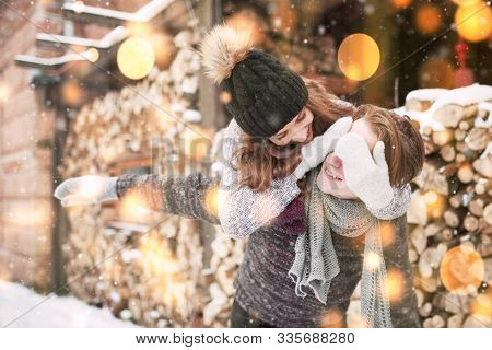 Couple Has Fun And Laughs. Kiss. Young Hipster Couple Hugging Each Other In Winter Park. Winter Love