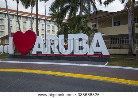 Big White Capital Letters I Love Aruba Along A Road In The Center Of Oranjestad, The Capital Of Arub