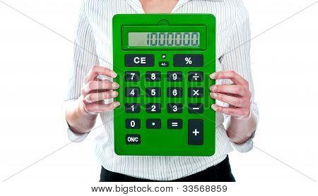 Focus On Green Calculator. Woman Holding