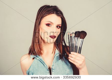 Girl Apply Eye Shadows. Woman Applying Makeup Brush. Emphasize Femininity. Professional Makeup Suppl