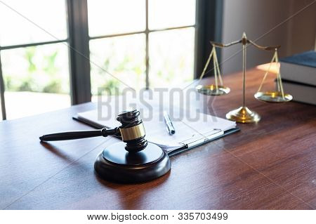 Judge Gavel With Justice At Law Firm In Background With Legal Case Document Contract, Law And Justic