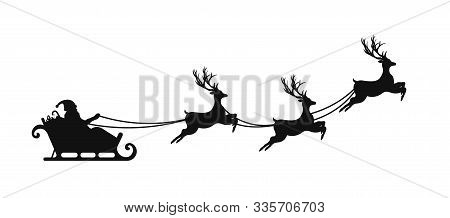Santa Claus Is Flying In Sleigh With Christmas Reindeer. Silhouette Of Santa Claus, Sleigh With Chri