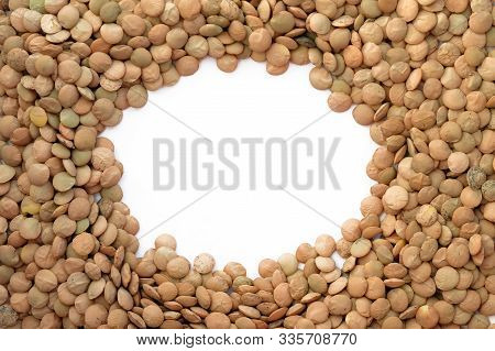 Raw Green Lentils Background. Grains Of Lentils With An Empty White Place In The Shape Of A Circle.