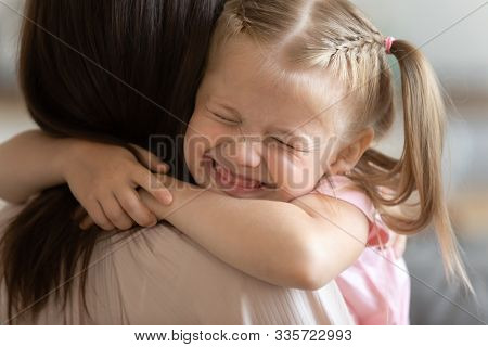 Funny Cute Little Girl Smiling Embracing Foster Care Parent Mum