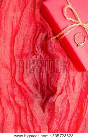 Artvagina. Textile Abstract Background. Soft Folds Of Pink Fabric In The Shape Of A Vagina, Gift Box