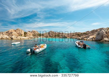 Unidentifiable Tourists On Small Boats In An Emerald Water Gulf - La Maddalena National Park - Parco