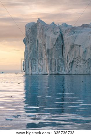 Iceberg At Sunset. Nature And Landscapes Of Greenland. Disko Bay. West Greenland. Summer Midnight Su