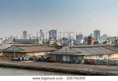 Ho Chi Minh City, Vietnam - March 13, 2019: Downtown Port On Song Sai Gon River. Low Level Old Wareh