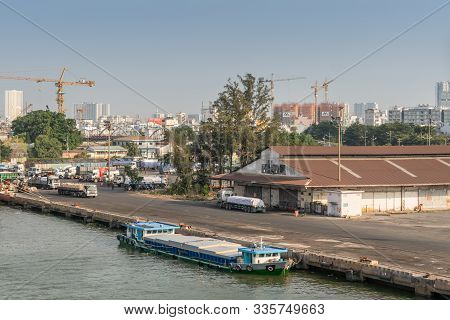 Ho Chi Minh City, Vietnam - March 13, 2019: Downtown Port On Song Sai Gon River At Sunset. Small Mod