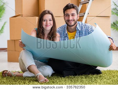 Young family planning home refurbishing in DIY concept poster