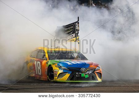 November 17, 2019 - Homestead, Florida, USA: Kyle Busch (18) wins the NASCAR Monster Energy NASCAR Cup Series Championship at Homestead-Miami Speedway in Homestead, Florida.