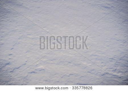 Pure White Pristine Snow. Texture Of White Snow With Shadows