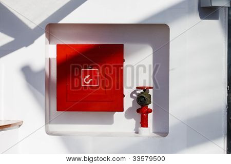 Fire Hose Connection On White Wall