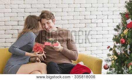 Caucasian Couple Celebrating Christmas Together. Man Gave Woman Surprise Gift. She Liked It Very Muc