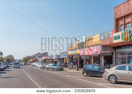 Middelburg, South Africa - May 22, 2019: A Street Scene, With Businesses, People And Vehicles, In Mi