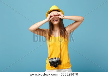 Traveler Tourist Woman In Yellow Summer Casual Clothes, Hat With Photo Camera Isolated On Blue Backg