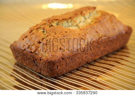 Banana Bread Loaf. Fresh Baked Home Made Banana Bread on Gold Foil background. Delicious home made Banana Bread. Food and Drink.