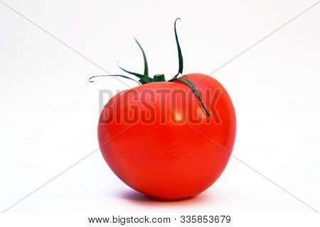 Red Tomato Isolated On White Background. Clipping Path . Fresh Tomato. Tomato Isolated On White Back