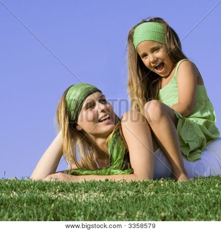 Happy Mother And Child Relaxing Outdoors