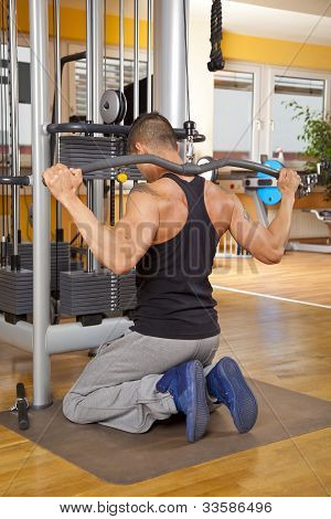 young man in his twenties exercising in gym