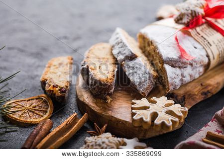 Stollen. Sliced Homemade Christmas Dessert Stollen With Dried Berries And Nuts On Stone  Rustic Tabl