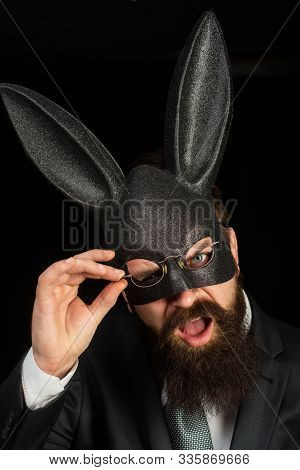 Funny Bearded Man In Carnival Rabbit Mask. Bearded Hipster In Suit Is Ready For Carnaval. Handsome M