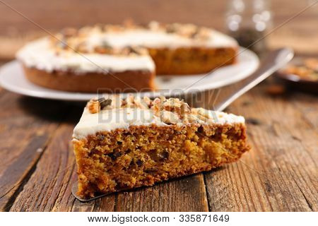 carrot cake with cream and nuts