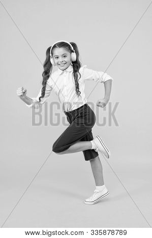 Energetic Back To School Songs That Will Get You Moving. Energetic Child Is Hurrying To School On Ye