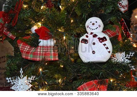 Sparkling Christmas Background With A Variety Of Red And White Ornaments, Along With Frosty The Snow
