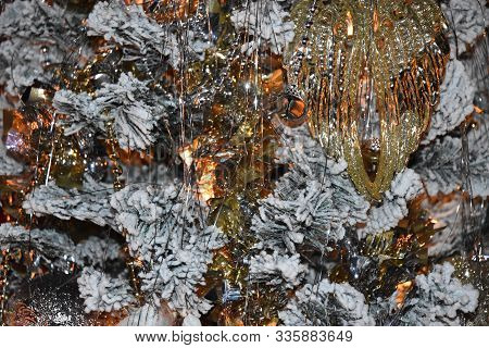 Sparkling Christmas Background With Silver, Gold Fur Branches And Snow