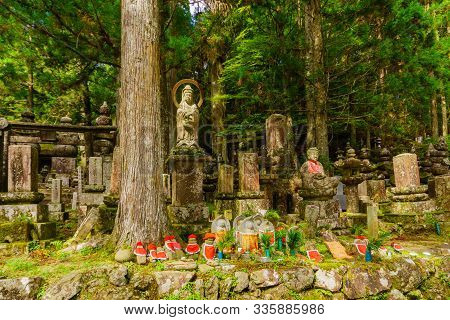 Koyasan, Japan - October 7, 2019: View Of Graves And Jizo (japanese Bodhisattva Statues Dressed In A