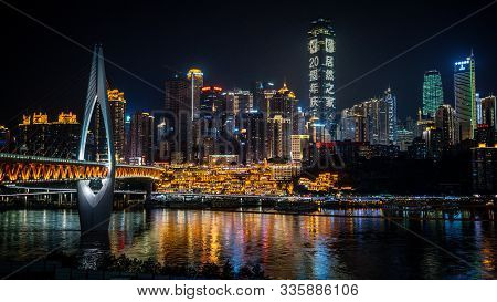 Chongqing China, 7 August 2019 : Chongqing City Nightscape With Bridge Buildings And Hongya Cave Vie