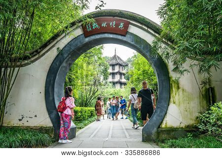 Chengdu China, 4 August 2019 : Chinese Arch Gate And Chinese Tourists At Du Fu Thatched Cottage Park