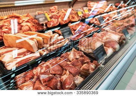 Selection Of Quality Meat At A Butcher Shop, Beef And Pork, Ham.